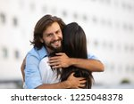 cheerful caucasian man hugging... | Shutterstock . vector #1225048378