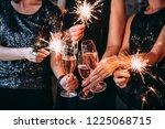 friends celebrating christmas... | Shutterstock . vector #1225068715