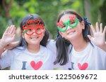 the bright smile of children on ... | Shutterstock . vector #1225069672
