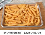 a baking pan with hot crinkle... | Shutterstock . vector #1225090705