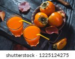 a glass of fresh juice and ripe ... | Shutterstock . vector #1225124275