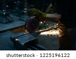 close up of a man sawing metal... | Shutterstock . vector #1225196122