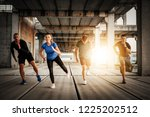 group of athletes exercises | Shutterstock . vector #1225202512