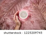 female hand  coffee cup and...   Shutterstock . vector #1225209745