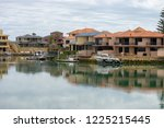 nice houses of australia right... | Shutterstock . vector #1225215445