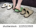 feet in green soft slippers on... | Shutterstock . vector #1225215505