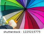 colored opened umbrella in the... | Shutterstock . vector #1225215775