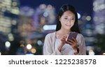 woman use of cellphone online | Shutterstock . vector #1225238578