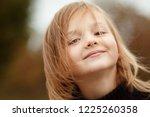 walk in the field. portrait of... | Shutterstock . vector #1225260358