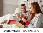 woman opening gift of necklace... | Shutterstock . vector #1225283872