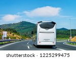 white tourist bus at the road... | Shutterstock . vector #1225299475