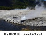 cliff geyser at the black sand... | Shutterstock . vector #1225375375