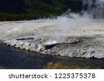 cliff geyser at the black sand... | Shutterstock . vector #1225375378