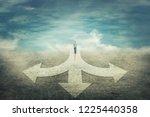 surreal view as a man walking... | Shutterstock . vector #1225440358