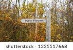 rural wooden footpath sign ...   Shutterstock . vector #1225517668
