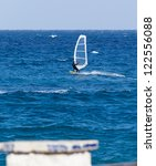 windsurfing on a sunny day | Shutterstock . vector #122556088