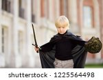 portrait of a cute little boy... | Shutterstock . vector #1225564498
