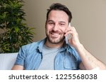 cheerful man making a phone... | Shutterstock . vector #1225568038