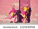 outdoor fashion. two young... | Shutterstock . vector #1225630948