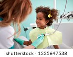 cute black kid show her teeth... | Shutterstock . vector #1225647538