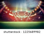 stadium in lights and flashes... | Shutterstock . vector #1225689982