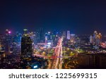 Small photo of JAKARTA - Indonesia. November 09, 2018: Aerial view of Jakarta city with glowing lights in hectic traffic at night time