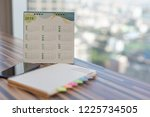 2019 calendar on table in... | Shutterstock . vector #1225734505