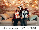 woman and kid holding present...   Shutterstock . vector #1225772818