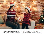 asian family celebrate at home...   Shutterstock . vector #1225788718