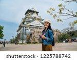 attractive traveler standing in ...   Shutterstock . vector #1225788742