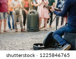 Street Musician Playing Guitar...