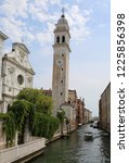 high white bell tower called... | Shutterstock . vector #1225856398