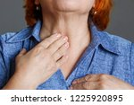 an elderly woman feels her... | Shutterstock . vector #1225920895