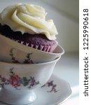 red velvet cupcake in a teacup | Shutterstock . vector #1225990618