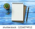 notebook on blue wooden table... | Shutterstock . vector #1226074912