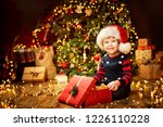 christmas child open present... | Shutterstock . vector #1226110228