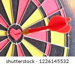 a red dart arrow hitting on...   Shutterstock . vector #1226145532