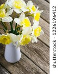 white daffodils at china vase... | Shutterstock . vector #1226196412