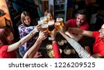 group of people celebrating in... | Shutterstock . vector #1226209525