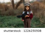 Child Girl In Cap Stands With...