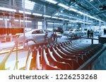 worker looks into car body on... | Shutterstock . vector #1226253268