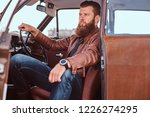 bearded male dressed in brown... | Shutterstock . vector #1226274295