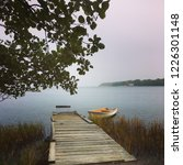 Small photo of Dreamy Swedish jetty and boat. Where would you sail and drift off to?