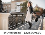 young stylish woman walking in...   Shutterstock . vector #1226309692