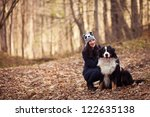 Stock photo beautiful girl with her dog in autumn forest bernese mountain dog 122635138