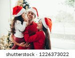 young family celebrating... | Shutterstock . vector #1226373022