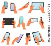 hands with gadgets vector hand... | Shutterstock .eps vector #1226377495
