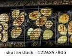 grilled zucchini cooking on an...