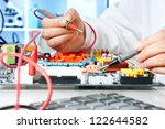 tech tests electronic equipment ... | Shutterstock . vector #122644582