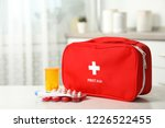 First Aid Kit With Pills On...